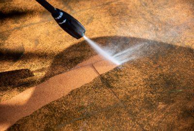 washing-the-backyard-tiles-with-high-pressure-clea-889FLKA